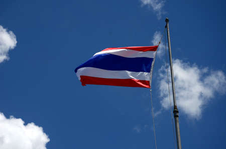 Flag of Thailand in cloud and blue sky photo