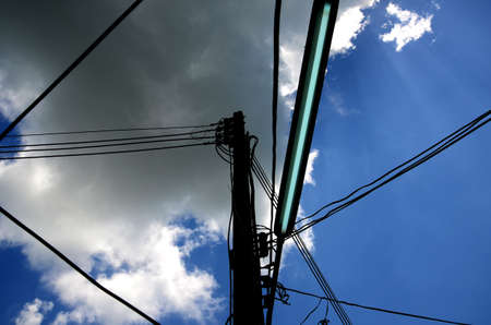 Pole and wires, Background Blue sky and Cloud photo