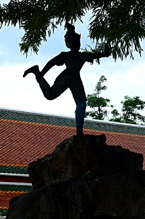 Silhouette, Statue in Wat Pho temple in Bangkok, Thailand photo