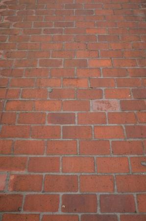 perspectiva lineal: piso de ladrillo, piso de ladrillo viejo antiguo naranja Vertical Foto de archivo