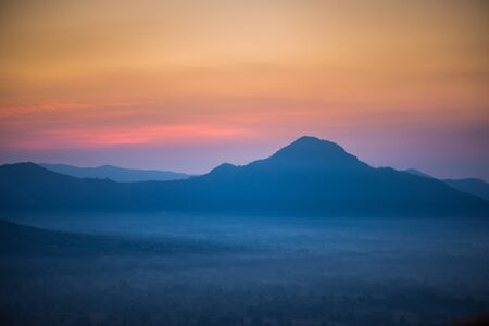 unseen: Sunrise cloud and mist on the topmost, Phu Tok mountain, Chiang Khan, Loei Unseen in Thailand - sunrise in the sea of mist at dawn (horizontal)