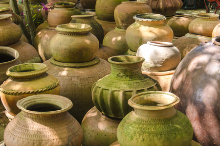 houseware: Group of Earthenware, Earthenware texture Background, Thai pottery container style.