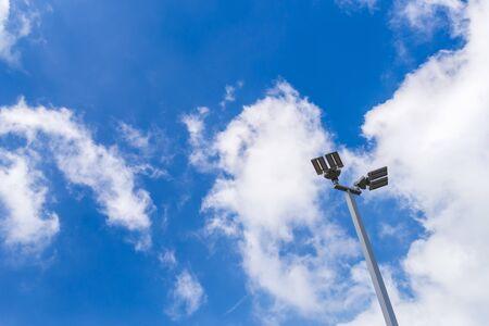 Illuminated street light lamp post against blue sky background Stock Photo