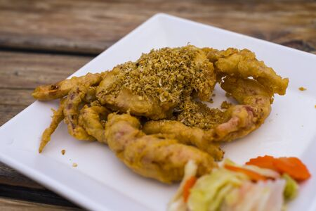 Fried Soft Shell Crab with Garlic on white plate, Thai food Stock Photo