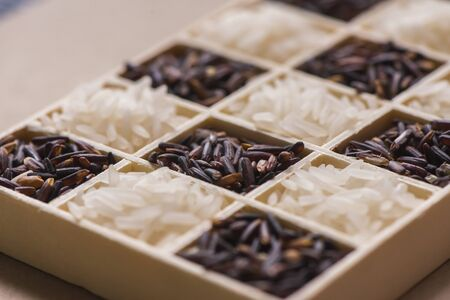 black and white rice in little wood box, Sensitive Focus Stock Photo