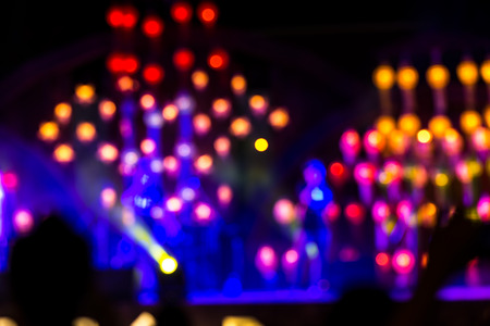 laser lights: Abstract background with defocused bokeh of laser show in modern disco party night club - Concept of nightlife with music and entertainment - Image with powered colored halos and vivid bright lights Stock Photo