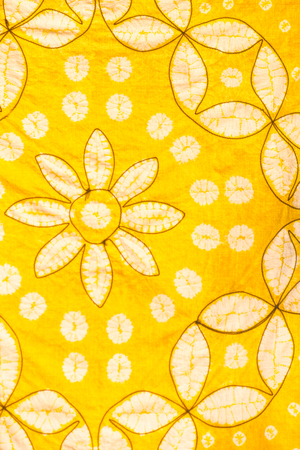 abstract yellow contour and salting pattern of painted silk batik on handmade scarf