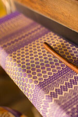 Beautiful traditional fabric Thai design, Purple and gold thread, sensitive Focus