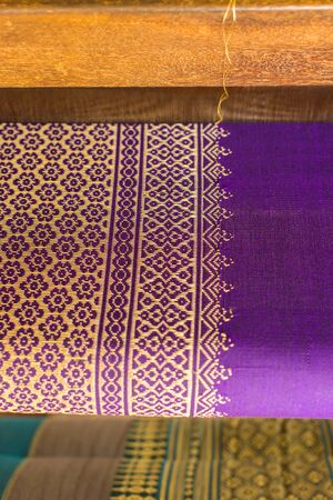 knew: Beautiful traditional fabric Thai design, Purple and gold thread, sensitive Focus