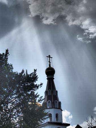 The rays of the sun illuminate the dome of the Orthodox Church. A natural phenomenon.