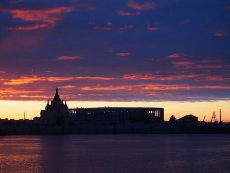 The red sunset. Look in Nizhny Novgorod on the Volga and Oka river and the St. Alexander Nevsky Cathedral and the stadium. Russia. Landscape.
