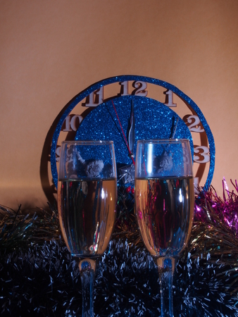 Glasses with champagne on the background of the clock