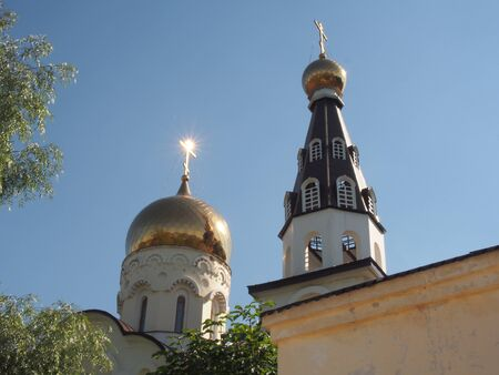 Dome of an Orthodox Church. The glare of the sun on the crosses of the Church. Shooting architecture.