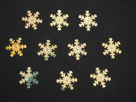 Colorful shiny stars on a black background. Winter background. Background photo.