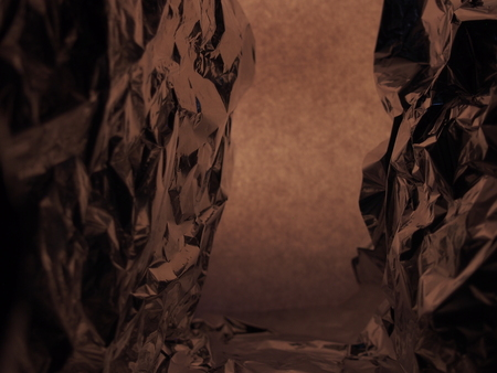 Passage between two rocks. Fantastic landscape of crumpled aluminum foil. Abstract background.