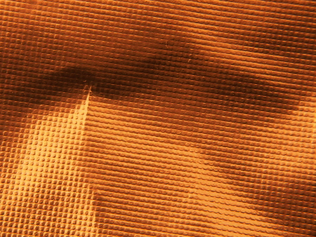 Golden metallic structure. The texture of the foil. Macrophotography.