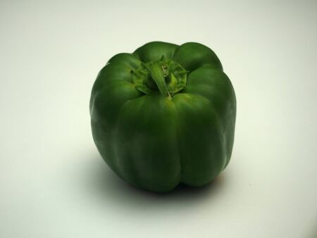 Large green fruit of sweet pepper. Photo on a white background. Food. Imagens