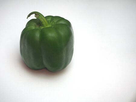 Large green fruit of sweet pepper. Photo on a white background. Food.
