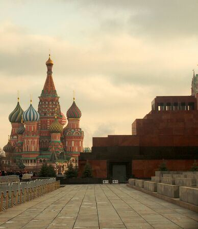 Red square in Moscow. Visible wall and towers of the Kremlin, Lenin Mausoleum and St. Basils Cathedral. Sight. Фото со стока