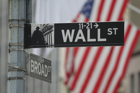 The New York street sign showing Wall Street outside the New York Stock Exchange