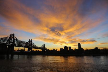 queensboro bridge: The sun begins to rise near the Queensboro Bridge in New York City on Monday, Jan. 20, 2015. (Gordon Donovan) Stock Photo