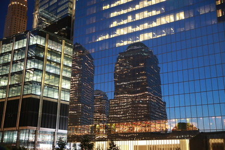 Buildings from Battery Park City reflect off 4 World Trade Center.