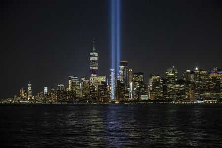 The Tribute in Light rises above the New York skyline is seen from the Staten Island Ferry on Aug. 30, 2019.