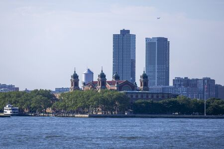 A view of Ellis Island from the Staten Island Ferry in New York City. Редакционное