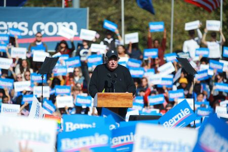 Filmmaker Michael Moore speaks at the Bernie's Back Rally in Long Island City, N.Y. on Saturday, Oct. 19, 2019. (Photo: Gordon Donovan) Фото со стока - 133263771