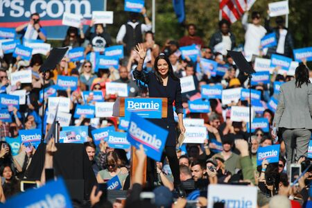 U.S. Representative Alexandria Ocasio-Cortez, Democrat of New York, speaks at the Bernie's Back Rally in Long Island City, NY. on Saturday, Oct. 19, 2019. (Photo: Gordon Donovan) Фото со стока - 133263779
