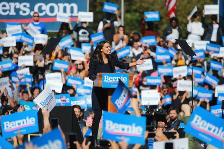 U.S. Representative Alexandria Ocasio-Cortez, Democrat of New York, speaks at the Bernie's Back Rally in Long Island City, NY. on Saturday, Oct. 19, 2019. (Photo: Gordon Donovan) Фото со стока - 133263780