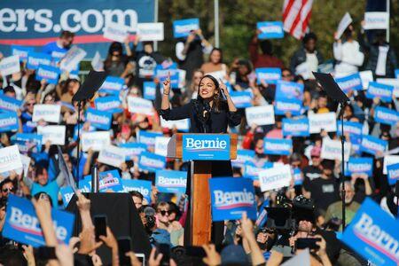 U.S. Representative Alexandria Ocasio-Cortez, Democrat of New York, speaks at the Bernie's Back Rally in Long Island City, NY. on Saturday, Oct. 19, 2019. (Photo: Gordon Donovan) Фото со стока - 133263783
