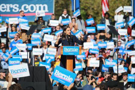 U.S. Representative Alexandria Ocasio-Cortez, Democrat of New York, speaks at the Bernie's Back Rally in Long Island City, NY. on Saturday, Oct. 19, 2019. (Photo: Gordon Donovan) Фото со стока - 133263790