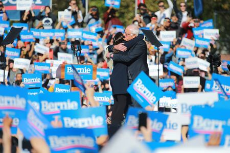 U.S. Representative Alexandria Ocasio-Cortez, Democrat of New York on stage with Vermont senator and Democratic presidential candidate Bernie Sanders at the Bernies Back Rally in Long Island City, N.Y. on Saturday, Oct. 19, 2019. (Photo: Gordon Donovan) Редакционное
