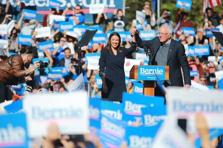 U.S. Representative Alexandria Ocasio-Cortez, Democrat of New York on stage with Vermont senator and Democratic presidential candidate Bernie Sanders at the Bernie's Back Rally in Long Island City, N.Y. on Saturday, Oct. 19, 2019. (Photo: Gordon Donovan) Stock fotó - 133263795