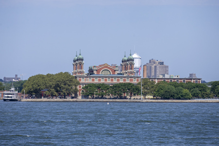 A view of the Ellis Island on board the Staten Island Ferry in New York City. Редакционное
