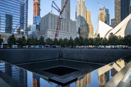 A view of Lower Manhattan from one of two reflecting pools at the National September 11 Memorial & Museum where the original One World Trade Center once stood, on Sept. 3, 2019. (Photo: Gordon Donovan)