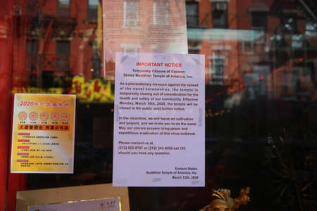 A sign posted in the window of store of closure in Chinatown on Sunday, March 15, 2020, in New York. (Photo: Gordon Donovan)