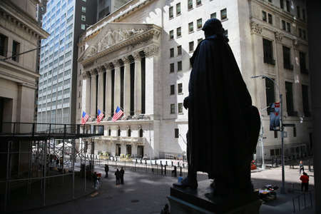 Popular tourist destinations like Wall Street in lower Manhattan are quiet over health concerns due to the coronavirus outbreak on Sunday, March 15, 2020, in New York. (Photo: Gordon Donovan) Sajtókép