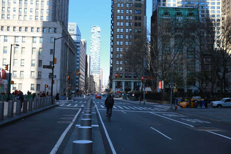 A few people and vehicles can be seen around the empty streets of lower Manhattan near the World Trade Center site on Sunday, March 15, 2020, in New York. (Photo: Gordon Donovan)