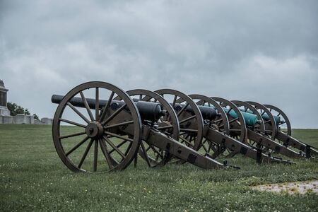 Old Civil War cannon line prepared for battle