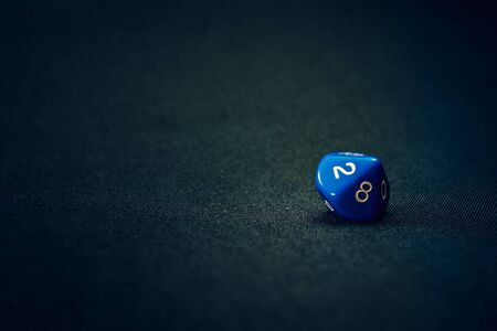 10 sided blue die for a game on a background