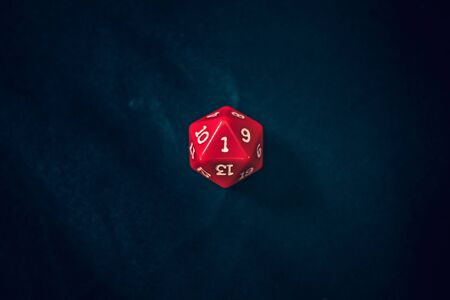 new 20 sided die with 1 face the camera Banco de Imagens