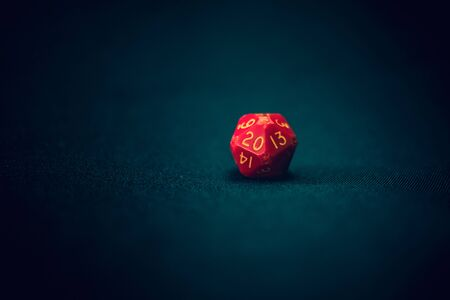 old damaged 20 sided die with 20 face the camera Banco de Imagens