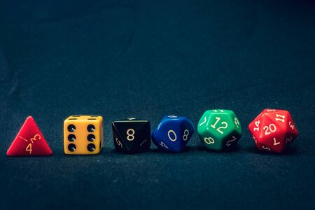 dice set of 6 line up on table with numbers facing