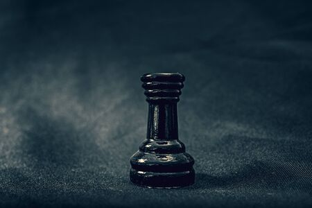 black glass Rook chess piece on background Banco de Imagens