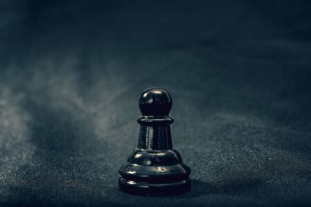 black glass Pawn chess piece on background Banco de Imagens