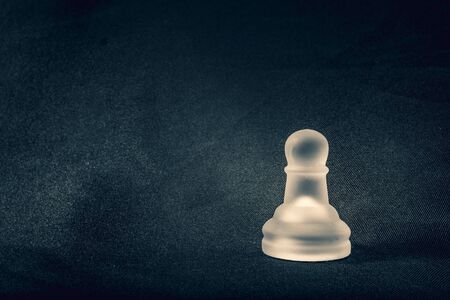 frosted white glass Pawn chess piece on background Banco de Imagens