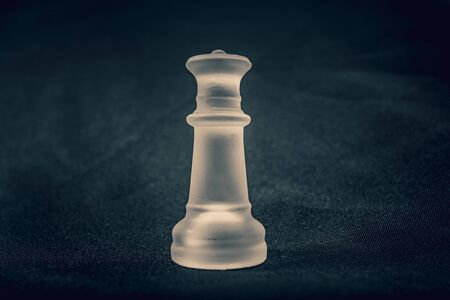 frosted white glass King chess piece on background