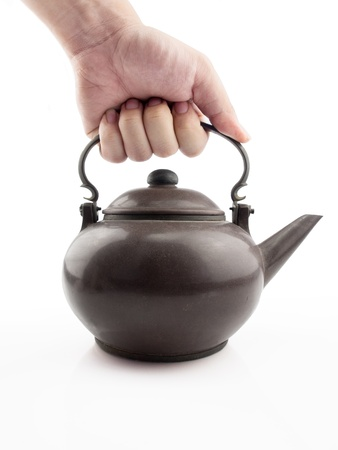 holding very old teapot photo